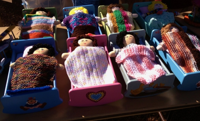 handmade dolls and wooden crib